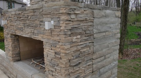 Cultured Stone Fireplace and Limestone Seatwall