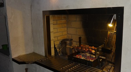 Fireplace with Rotisserie Insert and LED Lighting