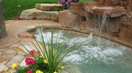 Hot Tub with Container of Annuals